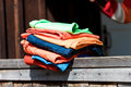 Stack of garment colourful on the wooden parapet Stock Image