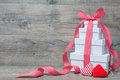 Stack of gift boxes with ribbon and bow on old wooden background Royalty Free Stock Photos