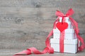Stack of gift boxes with ribbon and bow on old wooden background Royalty Free Stock Photography