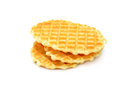 A stack of golden round waffles isolated on white background Royalty Free Stock Photo