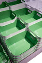 Stack of green plastic trays arrangement for background Royalty Free Stock Photo