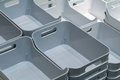 Stack of grey plastic trays arrangement for background. Royalty Free Stock Photo