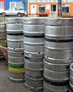 Stack of guinness beer kegs in ireland aluminum outside on the street near a pub county clare Stock Photo