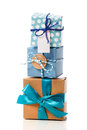 Stack of handcraft gift boxes blue colored on white background Royalty Free Stock Photo