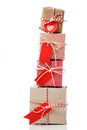 Stack of handcraft gift boxes red colored on white background Royalty Free Stock Photography