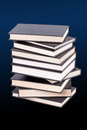 Stack of hardcover books in a blue background Stock Photos