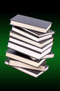 Stack of hardcover books in a green background Stock Images