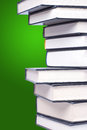 Stack of hardcover books in a green background Royalty Free Stock Photography