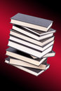 Stack of hardcover books in a red background Royalty Free Stock Images