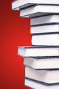 Stack of hardcover books in a red background Stock Images