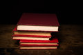 Stack of hardcover books on wood surface Royalty Free Stock Photography