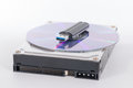 Stack of harddrive, compact disc and USB stick on white backgrou Royalty Free Stock Photo