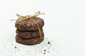 Stack of healthy chocolate, almond and chia seed cookies on white