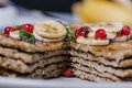 Stack of healthy low carbs oat pancakes over white wooden background Royalty Free Stock Photography