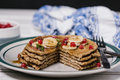 Stack of healthy low carbs oat pancakes over white wooden background Stock Photos