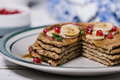 Stack of healthy low carbs oat pancakes over white wooden background Royalty Free Stock Photos