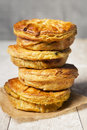 Stack of homemade meat pies on a rustic table Royalty Free Stock Photo