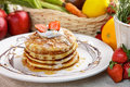 stack of homemade pancake with maple syrup and strawberry topping Royalty Free Stock Photo