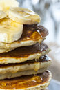Stack of homemade pancakes with banana slices and honey, close up. Royalty Free Stock Photo