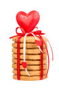 Stack of honey cake decorated with red ribbon and heart on white Stock Image