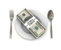 Stack of hundred dollar bills on a plate Stock Images