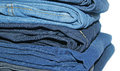 Stack of jeans isolated on white background Stock Image