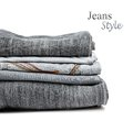 Stack of jeans trousers isolated on white background Stock Images