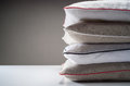 Stack of linen pillows four Stock Photography