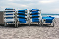 Stack of loungers on the beach blue Royalty Free Stock Photos