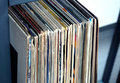 Stack of many vinyl records in old color covers on a shelf side view Royalty Free Stock Photo