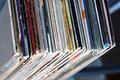 Stack of many vinyl records in old color covers on a shelf top view Royalty Free Stock Photo