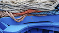 Stack of marine ropes on the stern blue wooden boat syracuse italy Royalty Free Stock Photo