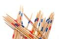 Stack of Mikado game wood sticks  on white background. Royalty Free Stock Photo