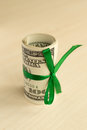 A stack of money with a ribbon. Expensive gift Royalty Free Stock Photo