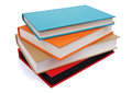Stack multi colored books isolated white Royalty Free Stock Images