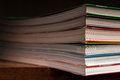 A stack of multicolored books on dark background Stock Photo