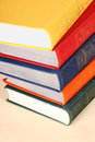 Stack multicolored thick hardcover books Stock Image