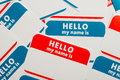 Stack of name tags or badges a blue and red hello my is Royalty Free Stock Photo
