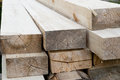 Stack of new wooden studs at the lumber yard. Wood timber construction material. Shallow depth field effect Royalty Free Stock Photo
