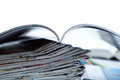 Stack of newspapers magazine and keyboard close up on white Royalty Free Stock Photo