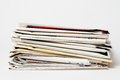 Stack of newspapers on white background Royalty Free Stock Photos