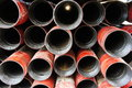 Stack of oil well intermediate casing bundles at box end Stock Photo