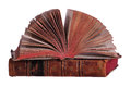 Stack of old books with fanned pages on white Stock Photo