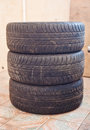 Stack of old car tire with erased tread Royalty Free Stock Photo