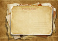 Stack of old papers  with a postcard Royalty Free Stock Photo