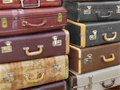 Stack of old suitcases and worn and luggage Royalty Free Stock Image