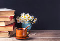 A stack of old vintage books lying on a wooden table. Country still life. Royalty Free Stock Photo