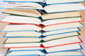 Stack of open books multicolored close up horizontal background Stock Images