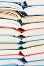 Stack of open books multicolored close up vertical background Stock Images