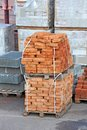 Stack of orange brick clay on pallet Royalty Free Stock Photo
